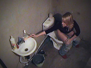 Sweet doll pissing and smoking on the toilet-bowl!